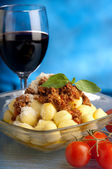 Gnocchi with ragout sauce — Stock Photo