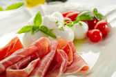 Mozzarella with parma ham — Stock Photo