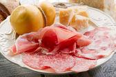 Variety of salami and cheese - varieta di saliumi e formaggi — Stock Photo