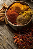Variety of spice on wood background — Foto Stock