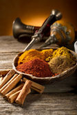 Variety of spice on wood background — Stock Photo