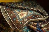 Variety of ancient oriental carpets — Stock Photo