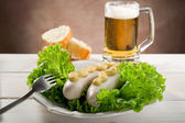 Wurstel with green salad — Stock Photo