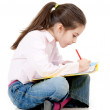 Stock Photo: Little girl studyng