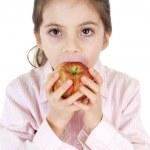 Little girl eating apple — Stock Photo #6511483