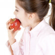 Little girl eating apple — Stock Photo
