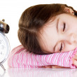 Little girl with alarm clock — Stok fotoğraf