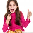 Little girl eating hamburger — Stock Photo #6511542