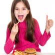 Little girl eating hamburger — Stock Photo