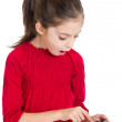 Little girl play with the smartphone — Stock Photo #6511580