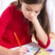 Little girl drawing - Stock Photo