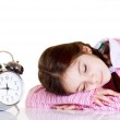Little girl with alarm clock — Stock Photo #6511608