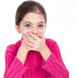 Young little girl covering mouth — Stock Photo
