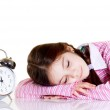 Little girl with alarm clock — Stock Photo #6511673