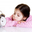 Little girl with alarm clock — Stock Photo #6511674