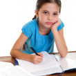 Bored little girl studying — Stock Photo