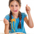 Cute little girl eating spaghetti — Stock Photo