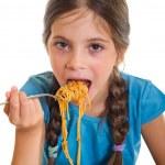 cute dziewczynka jedzenie spaghetti — Zdjęcie stockowe #6512008
