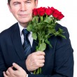 Man with roses - Stock Photo