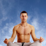 Man on yoga position against blue sky — Stock Photo #6516518