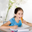 Child eats snack while studying — Stock Photo #6555416