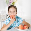 Stock Photo: Little girl with red apple