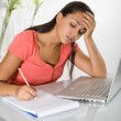 Bored girl with laptop homeworking — Stock Photo