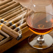 Cuban cigar and cognac on wood background — Stock Photo #6560219