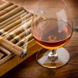 Stock Photo: Cubcigar and cognac on wood background
