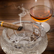 Cuban cigar and cognac on wood background - Stock Photo