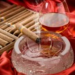Cubcigar and liquor over ash tray — Stock Photo #6577275