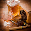 Stock Photo: Pipe tobacco cuban cigar and liquor