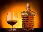 Glass and luxury bottle of liquor — Stock Photo