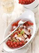 Octopus salad with redcurrant — Stock Photo