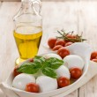 Buffalo mozzarella with basil and tomatoes - Stock Photo