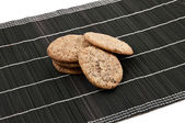 Some cookies on a black backhander — Foto de Stock