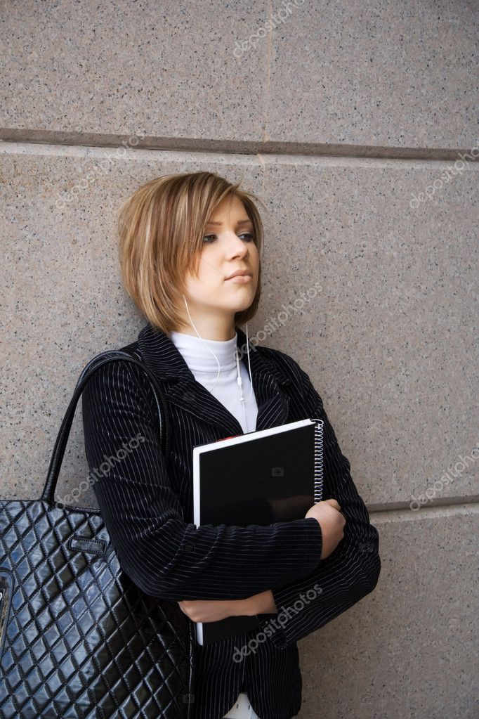 Young female student  worries before taking an exam.  Stock Photo #6175552