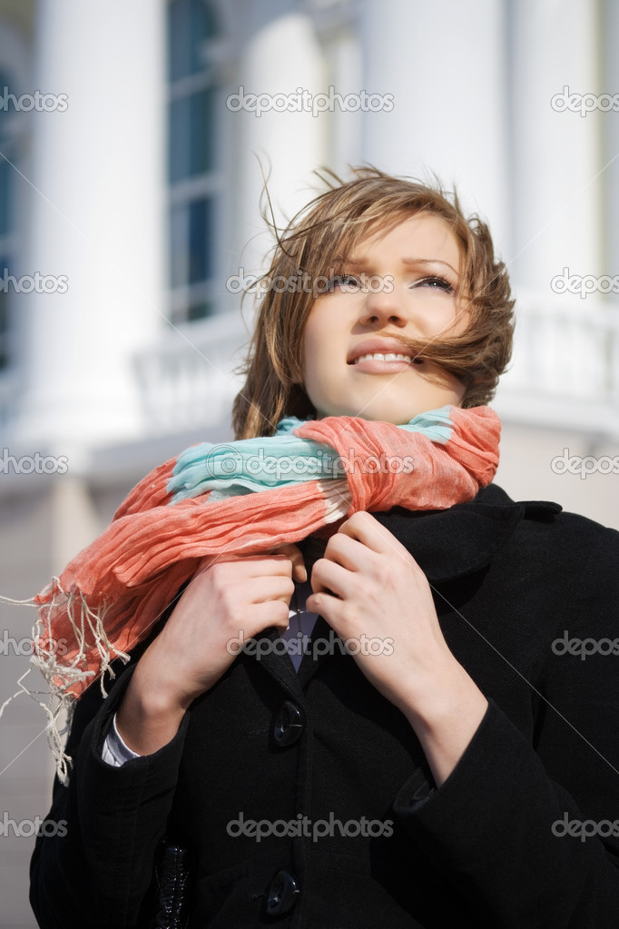 Young woman daydreaming on a city street  Stock Photo #6175556