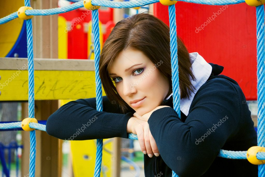 Thoughtful young woman daydreaming on the playground. — Stock Photo #6175565