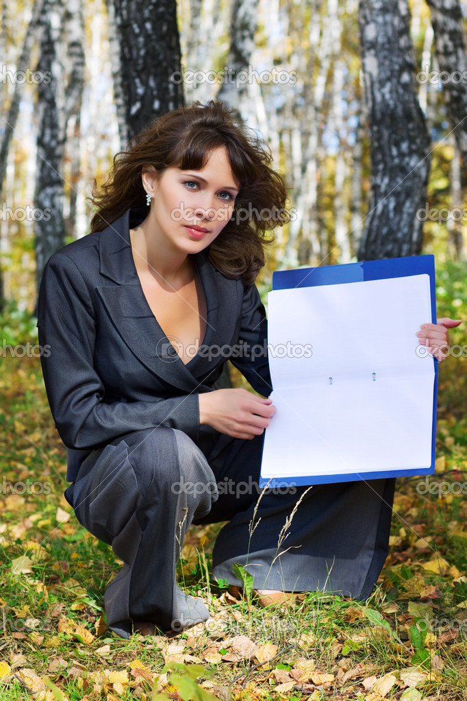 Young businesswoman holding a folder in the birch forest. — Stock Photo #6175580