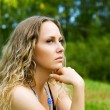 Royalty-Free Stock Photo: Sad young woman on nature