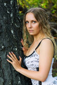 Beautiful woman in a forest — Stock Photo