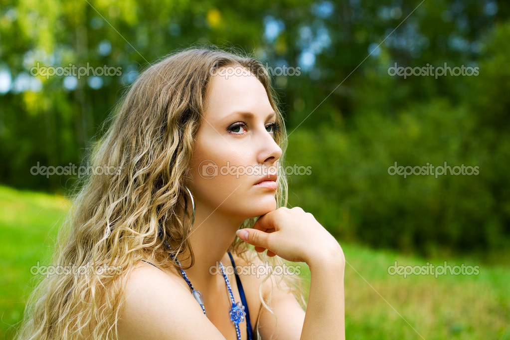Thoughtful young woman looking away on nature.  Stock Photo #6203497