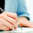Female hand signing contract — Stock Photo
