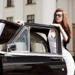 Royalty-Free Stock Photo: Young woman with a retro car