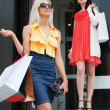Two young women with shopping bags — Stock Photo #6217875