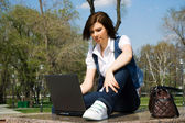 Young woman working on laptop — Stockfoto