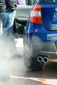 Exhaust pipe and fume gases — Stock Photo