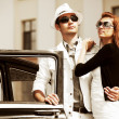 Stock Photo: Young couple with retro car