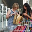 Royalty-Free Stock Photo: Two young women with shopping cart